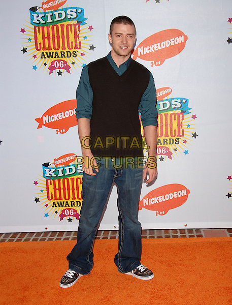 JUSTIN TIMBERLAKE.Arrivals at The Nickelodeon's 19th Annual Kids' Choice Awards held at UCLA's Pauley Pavilion in Westwood, California, USA, April 1st 2006..full length jeans sweater vest blue shirt brown trainers.Ref: DVS.www.capitalpictures.com.sales@capitalpictures.com.©Debbie VanStory/Capital Pictures