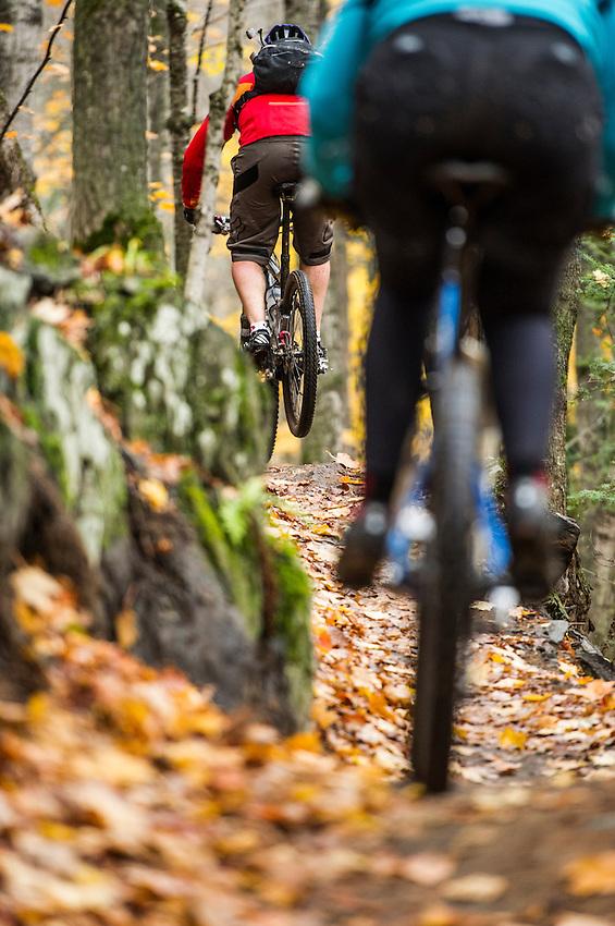 Mountain biking the Noquemanon Network's South Trails of Marquette Michigan in autumn.