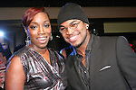 R&B singers Estelle and Ne-Yo pose on stage, during the 360 Induced Executive Mixer, hosted by Ne-Yo at Millesime NYC, January 19, 2011.