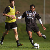 Roy Krishna passes under pressure from Andy Barron during the Wellington Phoenix A-League football training session Training Session at Newtown Park, Wellington, New Zealand on Monday, 4 May 2009. Photo: Dave Lintott / lintottphoto.co.nz