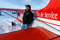 Sheldon Air Service pilot and owner David Lee stands next to his Cessna 185 on the Ruth Glacier <br /> <br /> Photo by Jeff Schultz/SchultzPhoto.com  (C) 2018  ALL RIGHTS RESERVED  Thurmer Tours July 2018