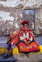 Peru, Ollantaytambo.  Quechua Grandmother and her Grandson.