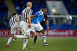 St Johnstone v St Mirren.....23.02.13      SPL.Gregory Tade gets away from Paul Dummett and Jim Goodwin.Picture by Graeme Hart..Copyright Perthshire Picture Agency.Tel: 01738 623350  Mobile: 07990 594431