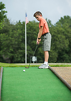 NWA Democrat-Gazette/BEN GOFF @NWABENGOFF<br /> Pierce Jacobson, 11, visiting from Texas, plays a round of miniature golf Wednesday, July 10, 2019, with his brothers at the Kingsdale Recreation Complex in Bella Vista.