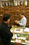 California: Chinatown San Francisco. Celebrity chef Martin Yan leads tour to herb shop. Photo #: chinatown-san-francisco-17-casanf16807. Photo copyright Lee Foster.