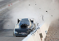 Oct 29, 2016; Las Vegas, NV, USA; NHRA funny car driver Jon Capps crashes into the wall during qualifying for the Toyota Nationals at The Strip at Las Vegas Motor Speedway. Capps was OK. Mandatory Credit: Mark J. Rebilas-USA TODAY Sports