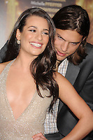 """HOLLYWOOD, CA - DECEMBER 05: Lea Michele and Ashton Kutcher arrive at the Los Angeles premiere of """"New Year's Eve"""" at Grauman's Chinese Theatre on December 5, 2011 in Hollywood, California."""