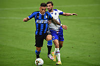 Lautaro Martinez of FC Internazionale and Bartosz Bereszynski of Sampdoria compete for the ball during the Serie A football match between FC Internazionale and UC Sampdoria at Stadio San Siro in Milano ( Italy ), June 21th, 2020. Play resumes behind closed doors following the outbreak of the coronavirus disease. <br /> Photo Image/Insidefoto