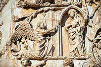 Bas-relief sculpture panel scene of the Annunciation to the Virgin Mary by Maitani around 1310 on the14th century Tuscan Gothic style facade of the Cathedral of Orvieto, Umbria, Italy