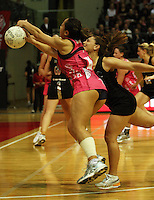 NZ's Temepara George beats Frances Solia to a pass during the International  Netball Series match between the NZ Silver Ferns and World 7 at TSB Bank Arena, Wellington, New Zealand on Monday, 24 August 2009. Photo: Dave Lintott / lintottphoto.co.nz
