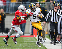 Iowa Hawkeyes running back Damon Bullock (5) is pushed out of bounds by Ohio State Buckeyes linebacker Curtis Grant (14) during Saturday's game in Columbus, Ohio on Saturday, Oct. 19, 2013. (Jabin Botsford / The Columbus Dispatch)