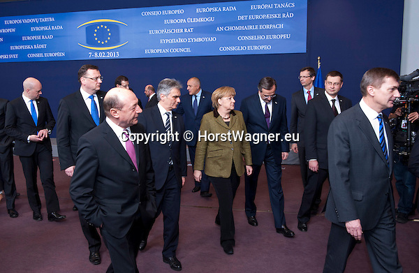 Brussels-Belgium - February 07, 2013 -- European Council, EU-summit meeting of Heads of State / Government; here, Angela MERKEL (ce), Federal Chancellor of Germany, leaving the scenery after posing for the family photo: with Fredrik REINFELDT (le), Prime Minister of Sweden; Petr NECAS (2.le), Prime Minister of Czech RepublicTraian BASESCU (2.le), President of Romania; Werner FAYMANN (3.le), Federal Chancellor of Austria; Janez JANSA (4.le), Prime Minister of SloveniaAntonis SAMARAS (4.ri), Prime Minister of Greece; Uwe CORSEPIUS (3.ri), Secretary-General of the EU-Council; Valdis DOMBROVSKIS (2.ri), Prime Minister of Latvia; Andrus ANSIP (ri), Prime Minister of Estonia -- Photo: © HorstWagner.eu