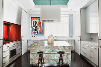 A carefully restricted palette in the kitchen ties the white units to the marble island; the green grain of the marble with the domed ceiling and the dark wood of the stools with the parquet floor