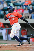 Right fielder Ydarqui Marte (12) of the Greeneville Astros bats in a game against the Bristol Pirates on Friday, July 25, 2014, at Pioneer Park in Greeneville, Tennessee. Greeneville won, 9-4. (Tom Priddy/Four Seam Images)
