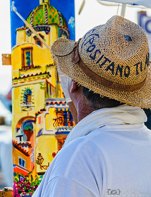 A local artist paints a view of the cathedral on the Positano waterfront on the amalfi Coast in Italy.