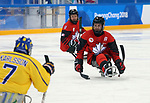 Pyeongchang, Korea, 10/3/2018-Tyler McGregor of Canada plays Sweden in hockey during the 2018 Paralympic Games in PyeongChang. Photo Scott Grant/Canadian Paralympic Committee.