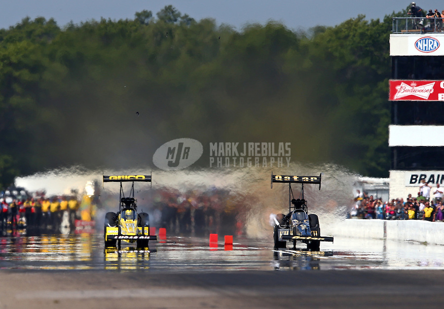 Aug. 17, 2013; Brainerd, MN, USA: NHRA top fuel dragster driver Morgan Lucas (left) races alongside Khalid Albalooshi during qualifying for the Lucas Oil Nationals at Brainerd International Raceway. Mandatory Credit: Mark J. Rebilas-