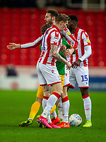 12th February 2020; Bet365 Stadium, Stoke, Staffordshire, England; English Championship Football, Stoke City versus Preston North End; James McClean of Stoke City pushes Ben Pearson of Preston North End