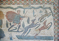 Hunter with dogs chasing a fox from the Room of The Small Hunt, no 25 - Roman mosaics at the Villa Romana del Casale which containis the richest, largest and most complex collection of Roman mosaics in the world, circa the first quarter of the 4th century AD. Sicily, Italy. A UNESCO World Heritage Site.