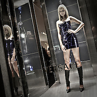 2010 edition of the Vogue Fashion Out in Milan.Model as dummy in Versace's window.
