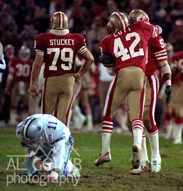 San Francisco 49ers vs. Dallas Cowboys at Candlestick Park Monday, December 19, 1983..49ers beat the Cowboys  42-17.San Francisco 49ers Defensive Back Ronnie Lott (42) and Linebacker Willie Harper (59) celebrate Sacking Dallas Cowboys Quarterback Danny White (11)...