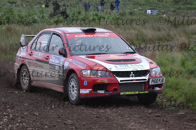John Morrison - Peter Carstairs in their Mitsubishi Lancer Evo 9 near Junction 6 on SS1 Ae East.....