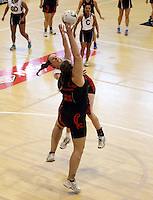 29.09.2014 Counties Manukau's Toni Rinckes and Eastern Waikato's Michelle Tupper during the  Counties Manukau v Eastern Waikato duing the Lion Foundation Netball Champs at the Trusts Stadium in Auckland. Mandatory Photo Credit ©Michael Bradley.