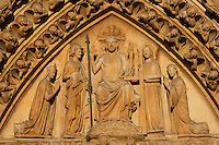 Christ, seated on His throne of glory, showing the wounds on his hands and his side with the two angels next to him bearing the instruments of the Passion, with Mary at his right and John at his left, Portal of the Last Judgement, west façade?s central portal, 1220 ? 1230, Notre Dame de Paris, 1163 ? 1345, initiated by the bishop Maurice de Sully, Ile de la Cité, Paris, France. Picture by Manuel Cohen