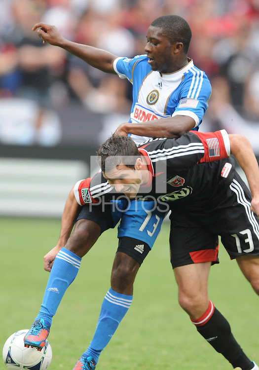 D.C. United forward Chris Pontius (13) gets fouled from Philadelphia Union midfielder Michael Lahoud (13)  D.C. United tied The Philadelphia Union 1-1 at RFK Stadium, Saturday August 19, 2012.