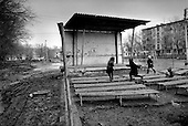 Atyrau, Kazakhstan .1998.Children play in the courtyard of a housing area in the oil rich capital of Atyrau. The people who live here have received no benefits from the oil that they live on. The oil is being developed by a consortium led by Chevron at Tengiz, five hours away..