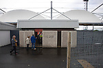 Visiting fans making their way through the turnstiles at the Gateshead International Stadium, the athletics stadium which is also the home ground of Gateshead FC, pictured on the day the club played host to Cambridge United in a Blue Square Bet Premier division fixture. The match ended in a one-all draw, watched by a crowd of 904. The point meant Gateshead went to the top of the division, one below the Football League in England.