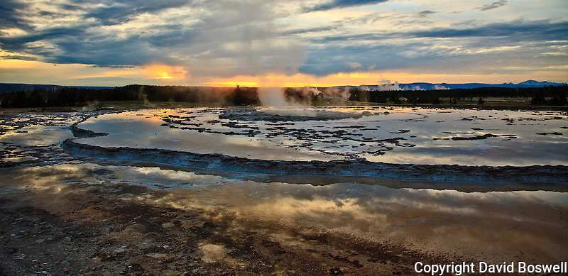 The sun setting over a quiet Great Fountain Geyser, on Firehole Lake Drive, Lower Geyser Basin of Yellowstone National Park