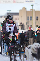 Blair Braverman and team leave the ceremonial start line with an Iditarider at 4th Avenue and D street in downtown Anchorage, Alaska on Saturday March 2nd during the 2019 Iditarod race. Photo by Brendan Smith/SchultzPhoto.com