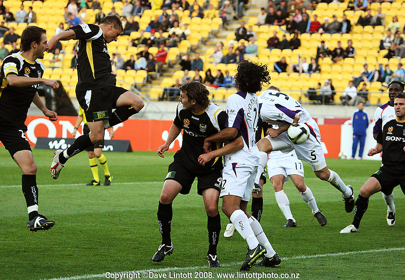 Ben Sigmund tries to head in a corner kick during the A-League football match between the Wellington Phoenix and Perth Glory at Westpac Stadium, Wellington, New Zealand on Saturday, 13 December 2008. Photo: Dave Lintott / lintottphoto.co.nz