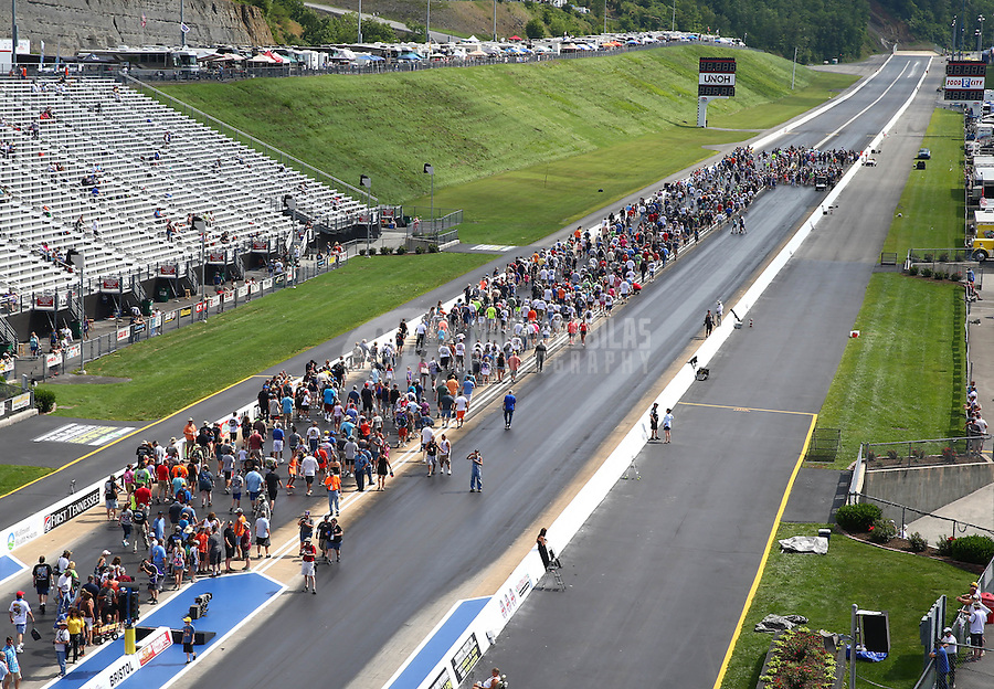 Jun 21, 2015; Bristol, TN, USA; NHRA An overview of fans participating in the Track Walk before first round of Eliminations at the Thunder Valley Nationals at Bristol Dragway. Mandatory Credit: Mark J. Rebilas-