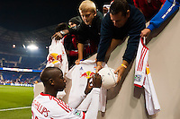 Bradley Wright-Phillips (99) of the New York Red Bulls signs autographs after the match. The New York Red Bulls defeated the Chicago Fire 5-2 during a Major League Soccer (MLS) match at Red Bull Arena in Harrison, NJ, on October 27, 2013.