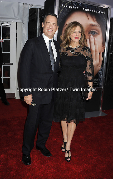 """Tom Hanks and wife Rita Wilson attend the New York Premiere of """" Extremely Loud & Incredibly Close"""" on December 15, 2011 at The Ziegfeld Theatre in New York City. The movie stars Tom Hanks, Sandra Bullock, Thomas Horn, Max von Sydow, Viola Davis and Jeffrey Wright."""