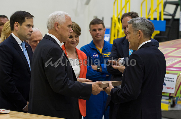 In this photo released by the National Aeronautics and Space Administration (NASA) United States Vice President Mike Pence, left, looks at a component of Orionís heat shield during a visit to the Operations and Checkout Building at Kennedy Space Center (KSC) on Thursday, July 6, 2017 in Cape Canaveral, Florida.  Looking on from left is US Senator Marco Rubio (Republican of Florida). Photo Credit: Aubrey Gemignani/NASA/CNP/AdMedia
