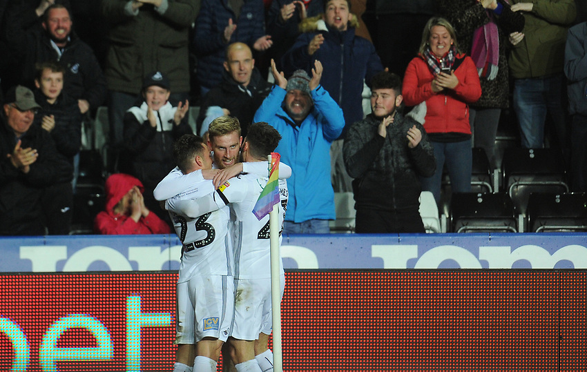 Swansea City's Oli McBurnie celebrates scoring the opening goal with team-mates Connor Roberts and Matt Grimes<br /> <br /> Photographer Kevin Barnes/CameraSport<br /> <br /> The EFL Sky Bet Championship - Swansea City v West Bromwich Albion - Wednesday 28th November 2018 - Liberty Stadium - Swansea<br /> <br /> World Copyright © 2018 CameraSport. All rights reserved. 43 Linden Ave. Countesthorpe. Leicester. England. LE8 5PG - Tel: +44 (0) 116 277 4147 - admin@camerasport.com - www.camerasport.com