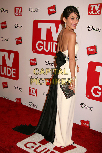 LISA EDELSTEIN.The TV Guide After Party following the 58th Annual Primetime Emmy Awards, Los Angeles, California, USA..August 27th, 2006.Ref: ADM/BP.full length white dress black bow looking over shoulder clutch purse strapless.www.capitalpictures.com.sales@capitalpictures.com.©Byron Purvis/AdMedia/Capital Pictures.