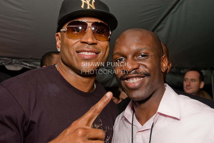 Image of LL Cool J and artist Shawn Punch at LL Cool J clothing launch party at Bryant Park Grill, September 11th, 2008.