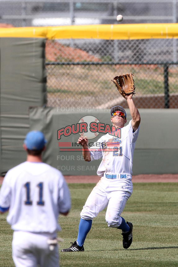 Chris Giovinazzo #21 of the UCLA Bruins catches a fly ball against the Cal. St. Bakersfield Roadrunners at Jackie Robinson Stadium in Los Angeles,California on May 14, 2011. Photo by Larry Goren/Four Seam Images