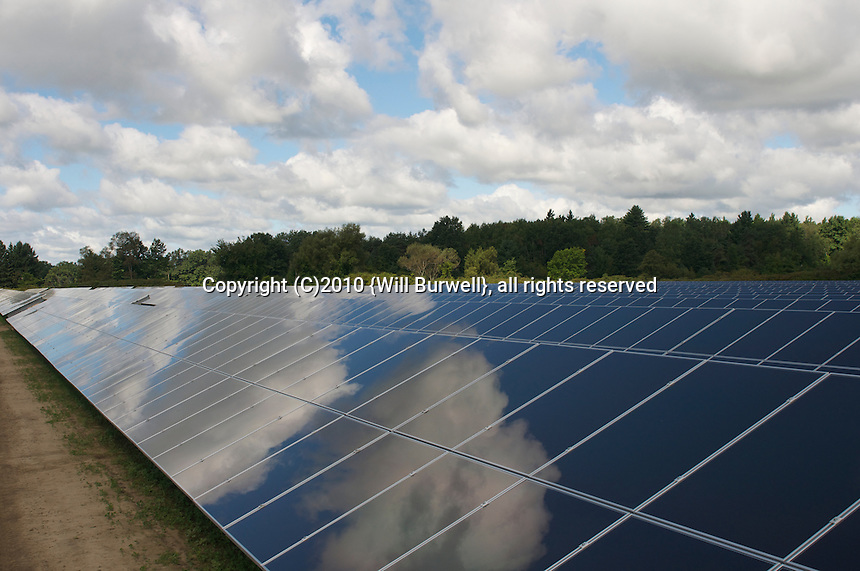 Solar panels with cloud reflections