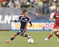 New England Revolution midfielder Diego Fagundez (14) looks to pass. In a Major League Soccer (MLS) match, the New England Revolution (blue) defeated Chicago Fire (red), 1-0, at Gillette Stadium on October 20, 2012.