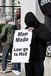 "© Joel Goodman - 07973 332324 . 20/06/2010 . London , UK . "" Man made law go to hell "" placard . A Muslims Against Crusades demonstraion calling for Sharia Law for All , on Richmond Terrace , Whitehall , opposite Downing Street . Photo credit : Joel Goodman"