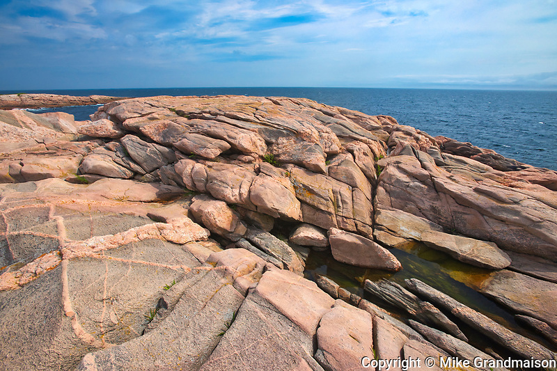 Rocky shoreline along the Cabot Strait (Atlantic Ocean) at Green Cove. Cabot Trail. Cape Breton Island.<br />
