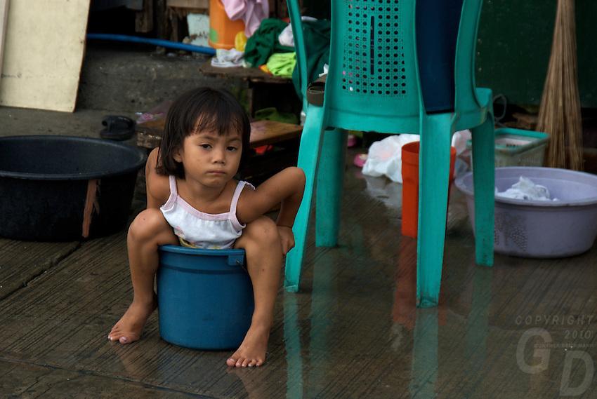 The poor mans toilet Manila Harbor and slum area view from the car window Manila, Philippines