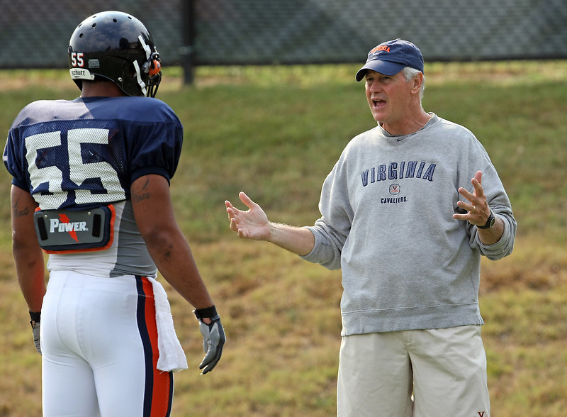Virginia head coach Al Groh, right, talk with Jared detrick, left, during practice on Thursday. Photo/Andrew Shurtleff