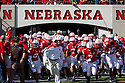 October 16, 2010: Nebraska Head Coach Bo Pelini leads the Huskers out on to the field before the play Texas at Memorial Stadium in Lincoln, Nebraska. Texas defeated Nebraska 20 to 13.