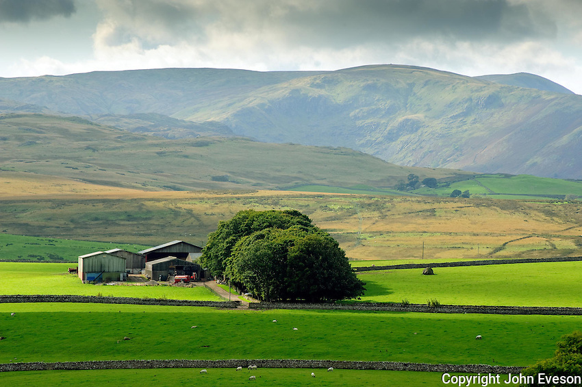 View of farmstead and fields near Shap, Cumbria....Copyright..John Eveson, Dinkling Green Farm, Whitewell, Clitheroe, Lancashire. BB7 3BN.01995 61280. 07973 482705.j.r.eveson@btinternet.com.www.johneveson.com